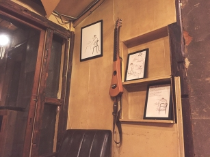 No hipster cafe is complete unless they have an ukelele hanging off the wall